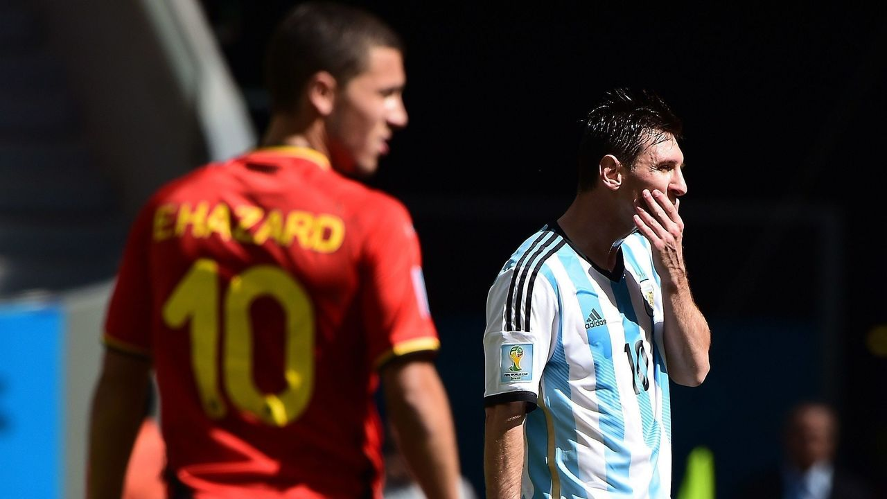 Argentina's forward Lionel Messi (R) reacts in front of Belgium's midfielder Eden Hazard during the second half of a quarter-final football match between Argentina and Belgium at the Mane Garrincha National Stadium in Brasilia during the 2014 FIFA World Cup on July 5, 2014. AFP PHOTO / FRANCOIS XAVIER MARIT