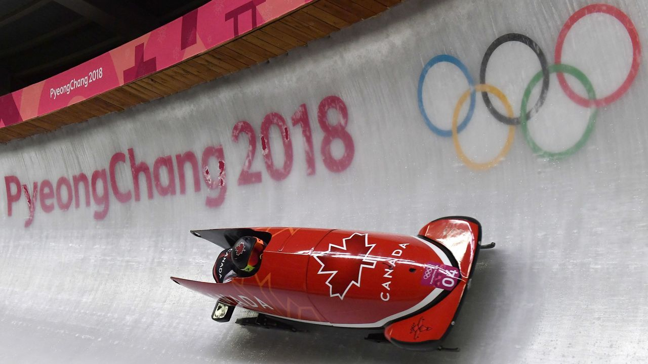 Canada's Kaillie Humphries Canada's Phylicia George compete in the women's bobsleigh heat 1 run during the Pyeongchang 2018 Winter Olympic Games, at the Olympic Sliding Centre on February 20, 2018 in Pyeongchang. / AFP PHOTO / MOHD RASFAN