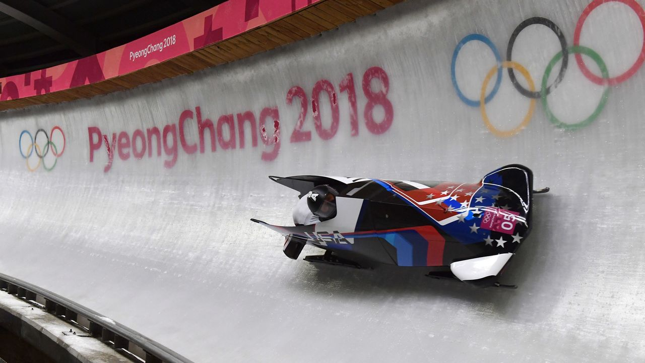 US Elana Meyers Taylor and US Lauren Gibbs compete in the women's bobsleigh heat 1 run during the Pyeongchang 2018 Winter Olympic Games, at the Olympic Sliding Centre on February 20, 2018 in Pyeongchang. / AFP PHOTO / MOHD RASFAN