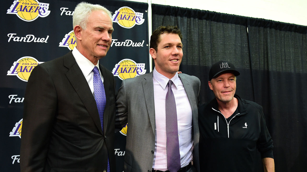 EL SEGUNDO, CA - JUNE 21: Luke Walton poses for a picture with Los Angeles Lakers General Manager Mitch Kupchak and part owner Jim Buss after he is introduced as the new head coach becoming the 26th Los Angeles Laker head coach at Toyota Sports Center on June 21, 2016 in El Segundo, California.