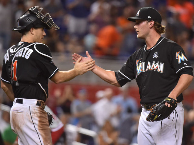 MIAMI, FL - SEPTEMBER 02: J.T. Realmuto #11 of the Miami Marlins congratulates Drew Steckenrider #71 after defeating the Philadelphia Phillies at Marlins Park on September 2, 2017 in Miami, Florida.
