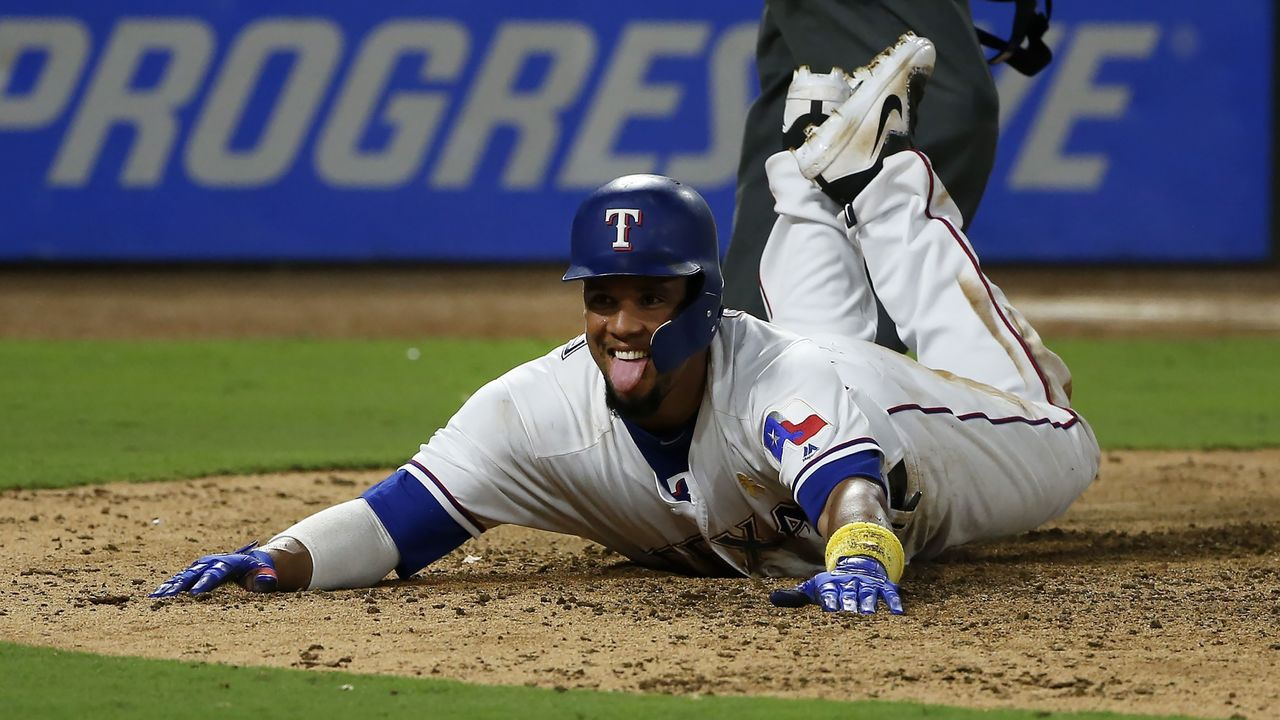 ARLINGTON, TX - SEPTEMBER 1: Carlos Gomez #14 of the Texas Rangers steals home on a wild pitch against the Los Angeles Angels of Anaheim during the eighth inning at Globe Life Park in Arlington on September 1, 2017 in Arlington, Texas.