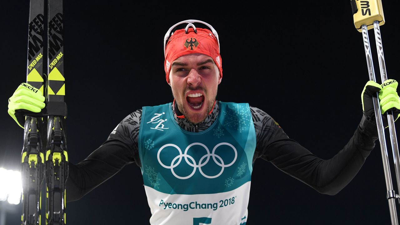 Gold medallist Germany's Johannes Rydzek celebrates after the nordic combined individual Gundersen LH/10km cross country at the Alpensia Cross-Country Centre during the Pyeongchang 2018 Winter Olympic Games on February 20, 2018 in Pyeongchang / AFP PHOTO / Christof STACHE