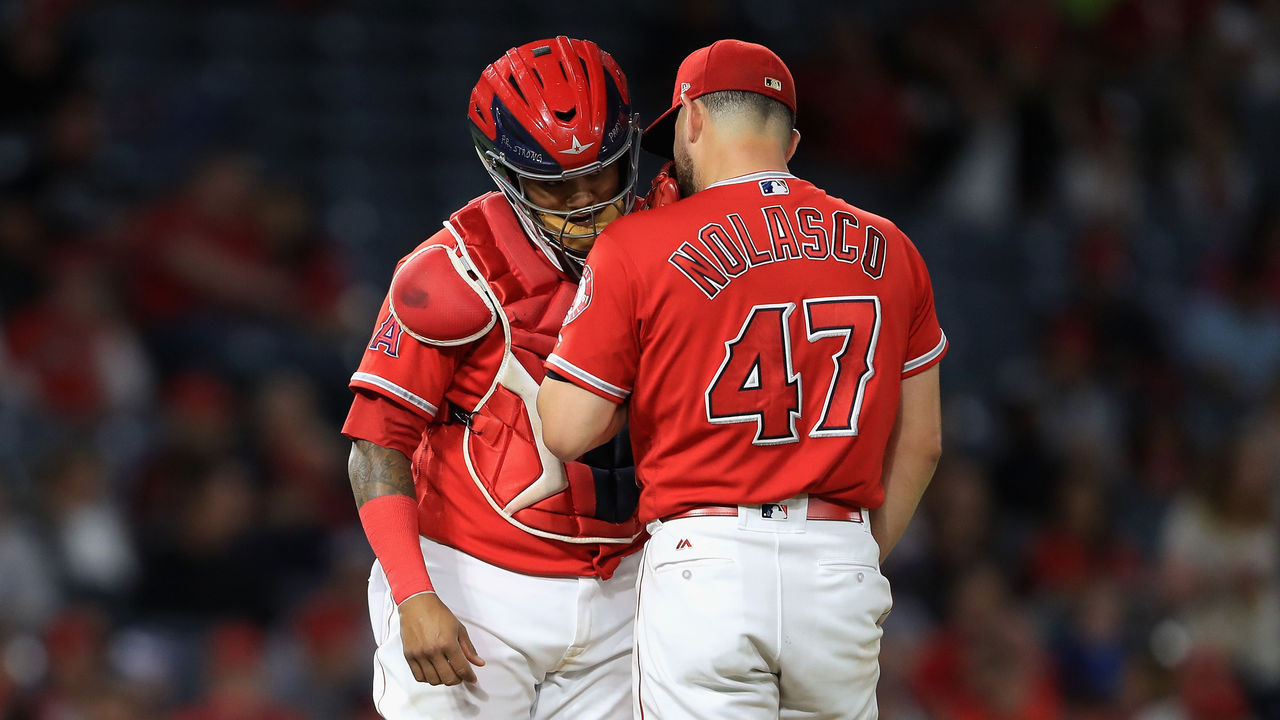 ANAHEIM, CA - SEPTEMBER 20: Martin Maldonado #12 talks with Ricky Nolasco #47 of the Los Angeles Angels of Anaheim during the second inning of a game against the Cleveland Indians at Angel Stadium of Anaheim on September 20, 2017 in Anaheim, California.