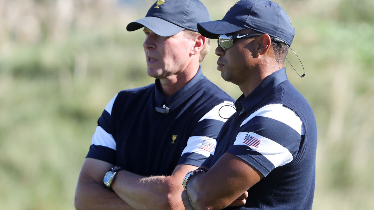 JERSEY CITY, NJ - SEPTEMBER 28: Captain's assistant Tiger Woods and Captain Steve Stricker of the U.S. Team talk during Thursday foursome matches of the Presidents Cup at Liberty National Golf Club on September 28, 2017 in Jersey City, New Jersey.