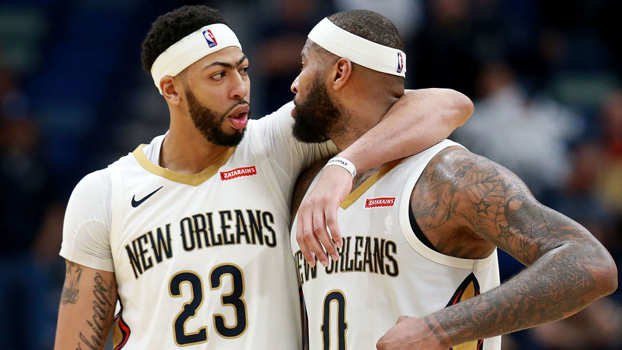 NEW ORLEANS, LA - JANUARY 22: Anthony Davis #23 of the New Orleans Pelicans and DeMarcus Cousins #0 of the New Orleans Pelicans walk of the court during a NBA game against the Chicago Bulls at the Smoothie King Center on January 22, 2018 in New Orleans, Louisiana.