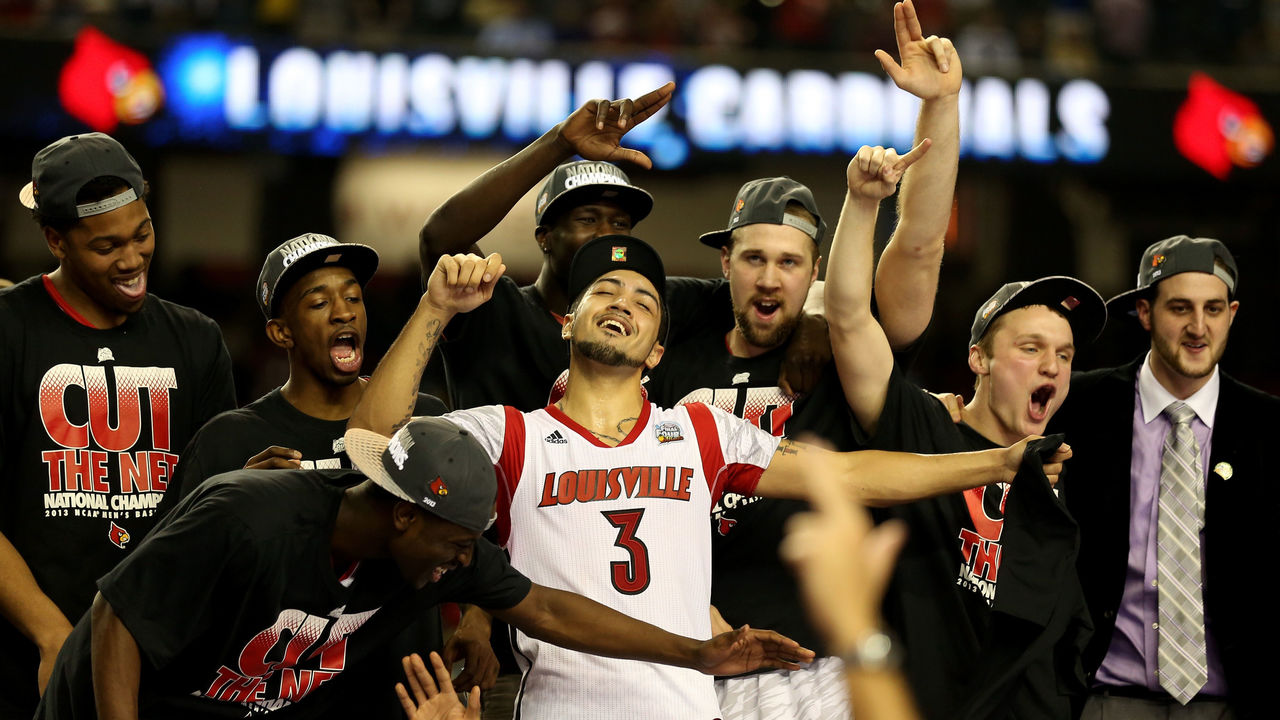 ATLANTA, GA - APRIL 08: Peyton Siva (C) #3 and RUss Smith #2 (L of Siva) of the Louisville Cardinals celebrate with teammates after they defeated the Michigan Wolverines during the 2013 NCAA Men's Final Four Championship at the Georgia Dome on April 8, 2013 in Atlanta, Georgia.