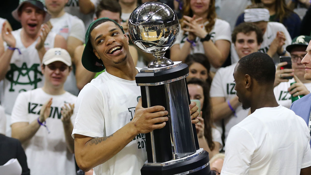 EAST LANSING, MI - FEBRUARY 20: Miles Bridges #22 of the Michigan State Spartans holds the Big Ten trophy after the Spartan defeated the Illinois Fighting Illini at Breslin Center on February 20, 2018 in East Lansing, Michigan.