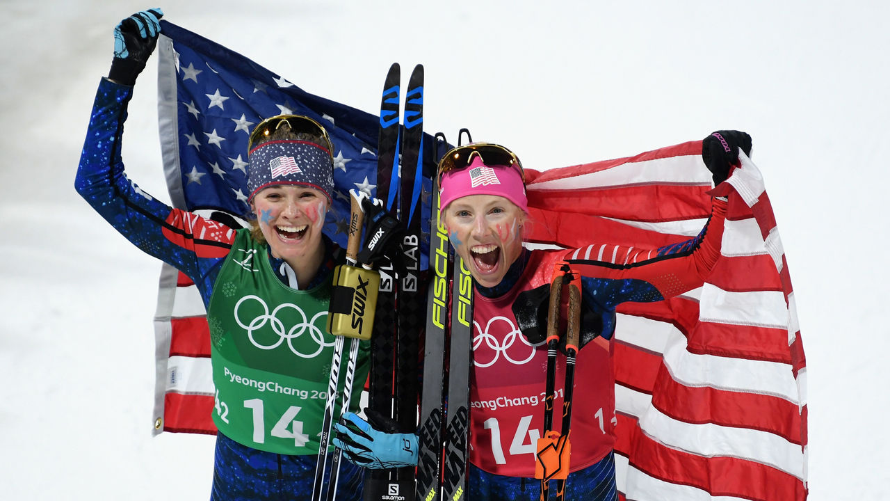PYEONGCHANG-GUN, SOUTH KOREA - FEBRUARY 21: Jessica Diggins of the United States (L) and Kikkan Randall of the United States celebrate as they win gold during the Cross Country Ladies' Team Sprint Free Final on day 12 of the PyeongChang 2018 Winter Olympic Games at Alpensia Cross-Country Centre on February 21, 2018 in Pyeongchang-gun, South Korea.