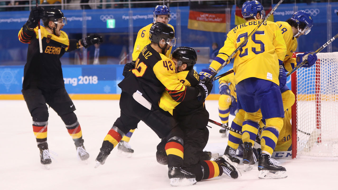 GANGNEUNG, SOUTH KOREA - FEBRUARY 21: Patrick Reimer #37 of Germany reacts after scoring the game winning goal in overtime against Sweden to win 4-3 during the Men's Play-offs Quarterfinals game on day twelve of the PyeongChang 2018 Winter Olympic Games at Kwandong Hockey Centre on February 21, 2018 in Gangneung, South Korea.