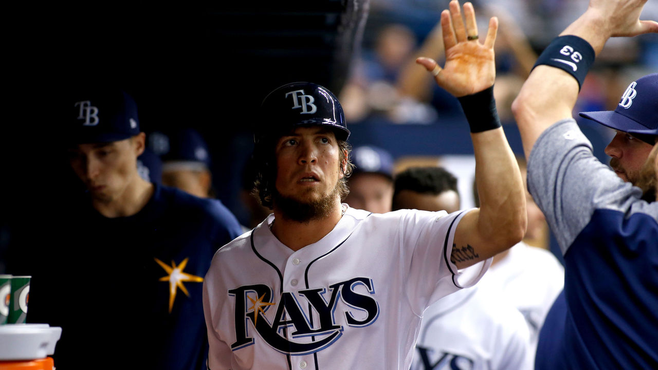 ST. PETERSBURG, FL - MAY 9: Colby Rasmus #28 of the Tampa Bay Rays celebrates in the dugout with teammate Derek Norris #33 after scoring off of an RBI single by Tim Beckham #1 during the fifth inning of a game against the Kansas City Royals on May 9, 2017 at Tropicana Field in St. Petersburg, Florida.