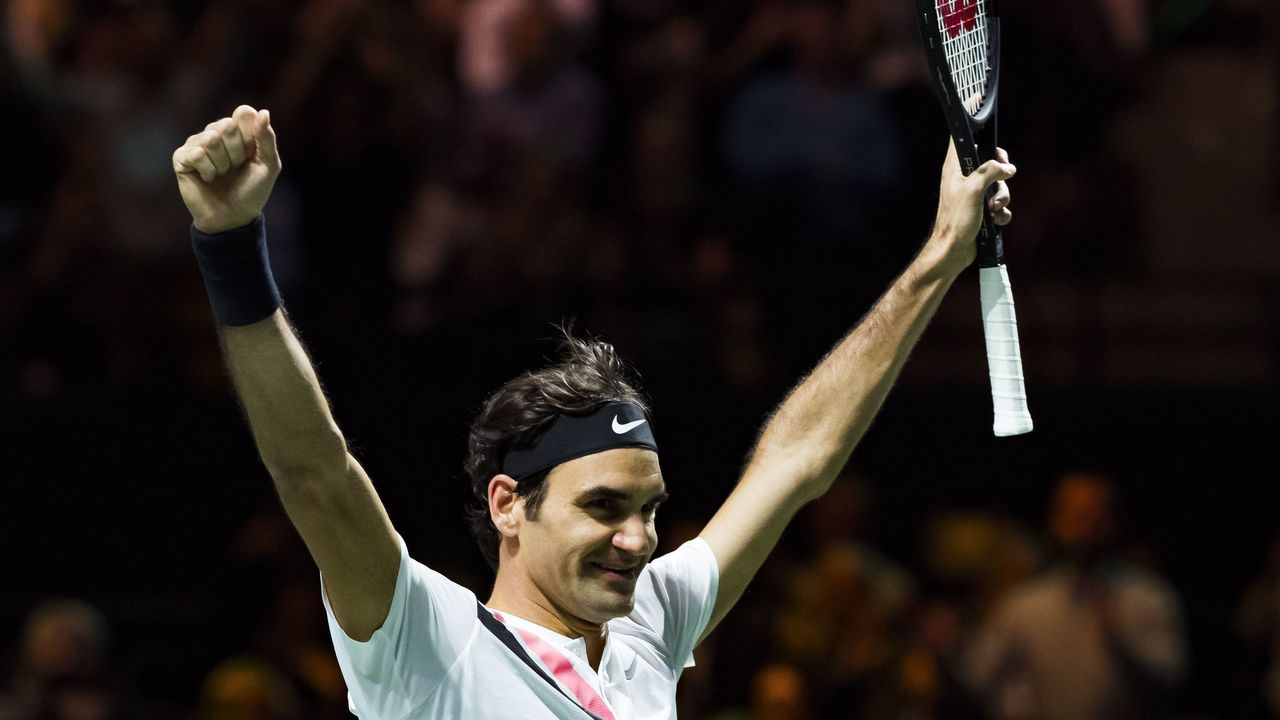 TOPSHOT - Roger Federer of Switzerland celebrates after victory against Grigor Dimitrov of Bulgaria during their men's singles final for the ABN AMRO World Tennis Tournament in Rotterdam on February 18, 2018. / AFP PHOTO / ANP / Koen Suyk / Netherlands OUT