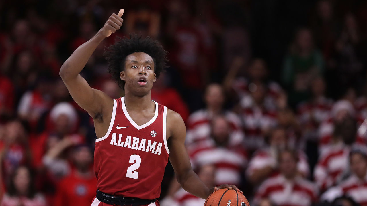 TUCSON, AZ - DECEMBER 09: Collin Sexton #2 of the Alabama Crimson Tide handles the ball during the first half of the college basketball game against the Arizona Wildcats at McKale Center on December 9, 2017 in Tucson, Arizona. The Cardinals defeated the Titans 12-7.