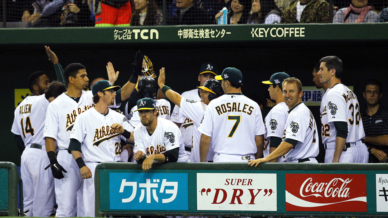 TOKYO, JAPAN - MARCH 29: The Oakland Athletics celebrate a two run home run by Yoenis Cespedes #52 in the seventh inning against the Seattle Mariners during a MLB game at Tokyo Dome on March 29, 2012 in Tokyo, Japan.