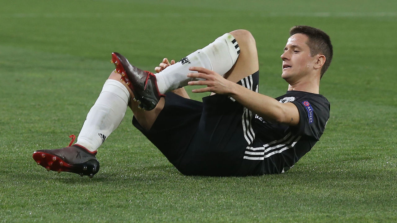 SEVILLE, SPAIN - FEBRUARY 21: Ander Herrera of Manchester United lies injured during the UEFA Champions League Round of 16 First Leg match between Sevilla FC and Manchester United at Estadio Ramon Sanchez Pizjuan on February 21, 2018 in Seville, Spain.
