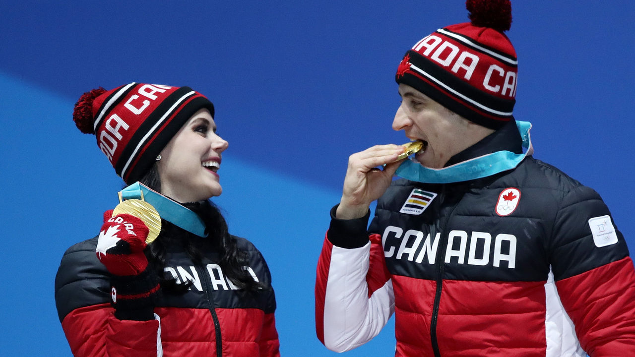 PYEONGCHANG-GUN, SOUTH KOREA - FEBRUARY 20: Gold medalists Tessa Virtue and Scott Moir of Canada celebrate during the medal ceremony for Figure Skating - Ice Dance Free Dance on day 11 of the PyeongChang 2018 Winter Olympic Games at Medal Plaza on February 20, 2018 in Pyeongchang-gun, South Korea.