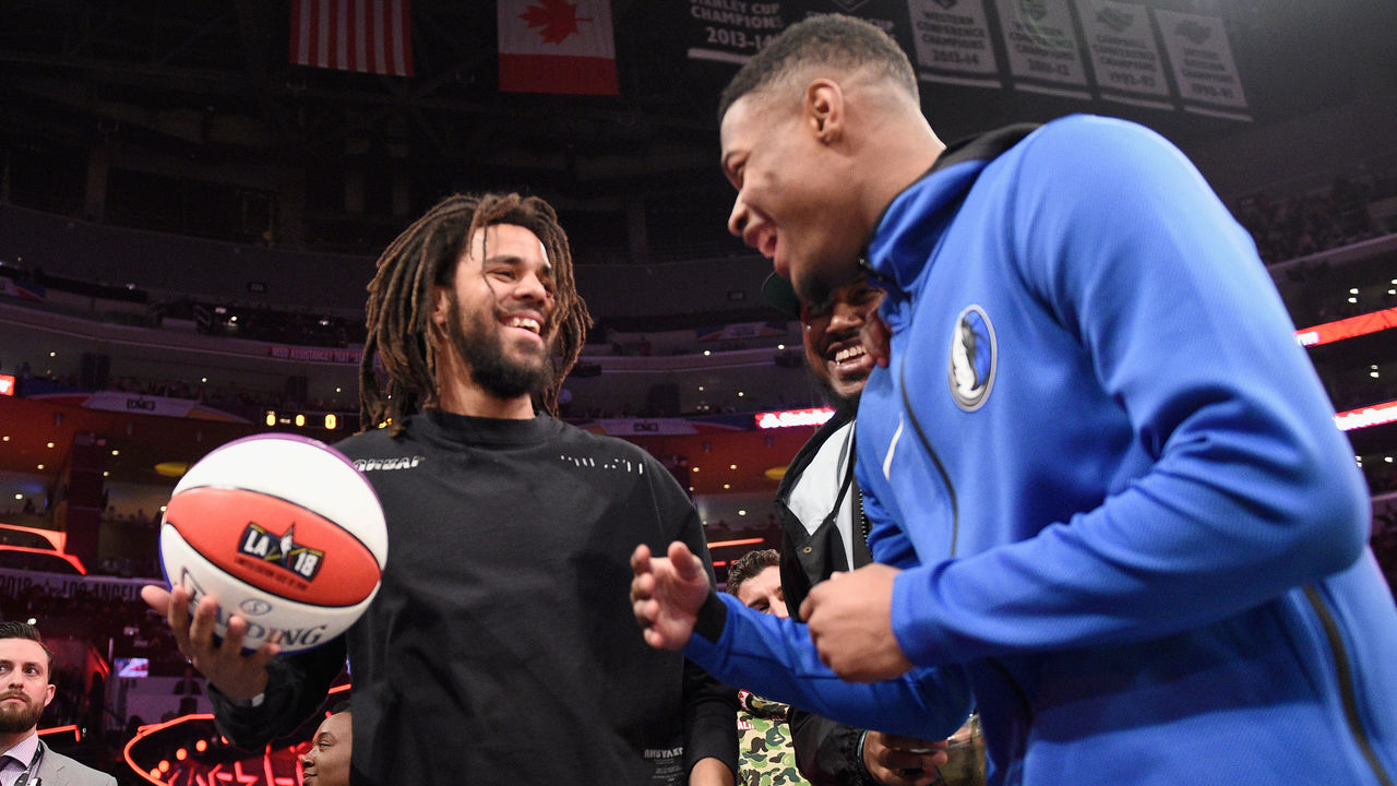 LOS ANGELES, CA - FEBRUARY 17: J. Cole and Dennis Smith Jr. attend the 2018 Verizon Slam Dunk Contest at Staples Center on February 17, 2018 in Los Angeles, California.