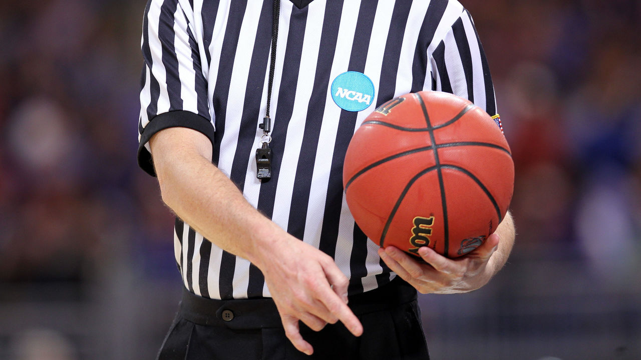 ST. LOUIS, MO - MARCH 23: : : A detail of an NCAA referee holding an official wilson NCAA tournament basketball as the North Carolina State Wolfpack play against the Kansas Jayhawks during the 2012 NCAA Men's Basketball Midwest Regional Semifinal at Edward Jones Dome on March 23, 2012 in St. Louis, Missouri.