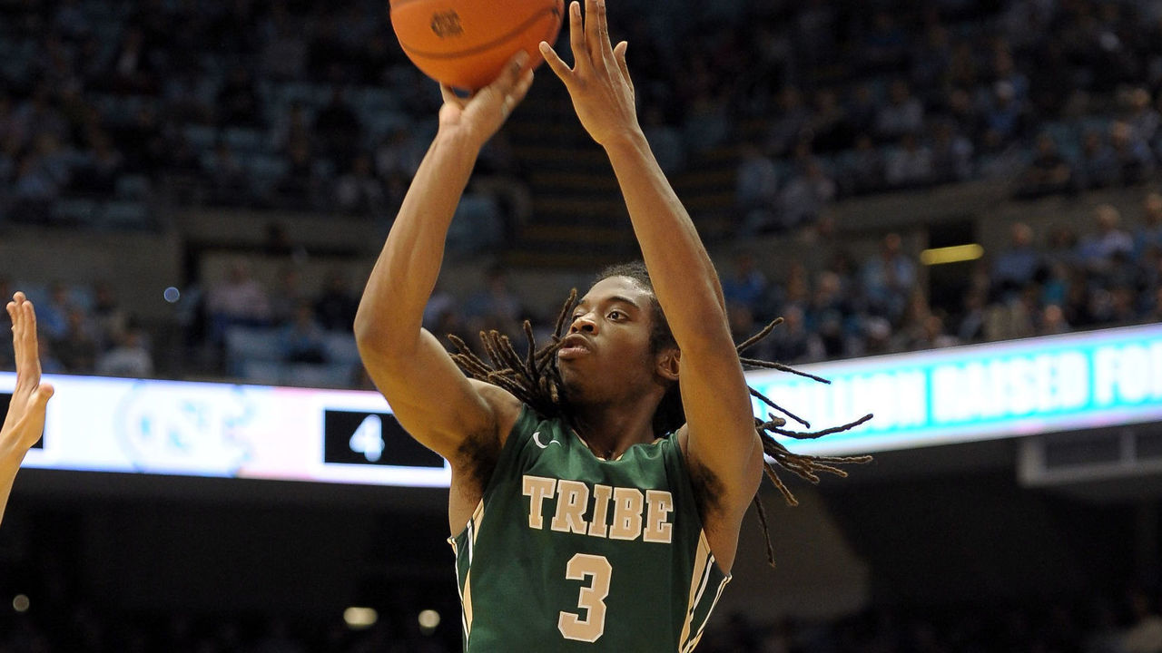 CHAPEL HILL, NC - DECEMBER 30: Marcus Thornton #3 of the William & Mary Tribe puts up a shot against the North Carolina Tar Heels during their game at the Dean Smith Center on December 30, 2014 in Chapel Hill, North Carolina.