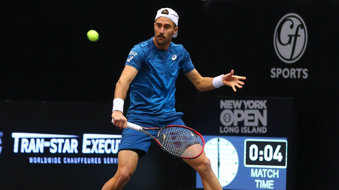 UNIONDALE, NY - FEBRUARY 13: Steve Johnson of the United States returns during his doubles match in the New York Open on February 13, 2018, at NYCB Live in Uniondale, NY.