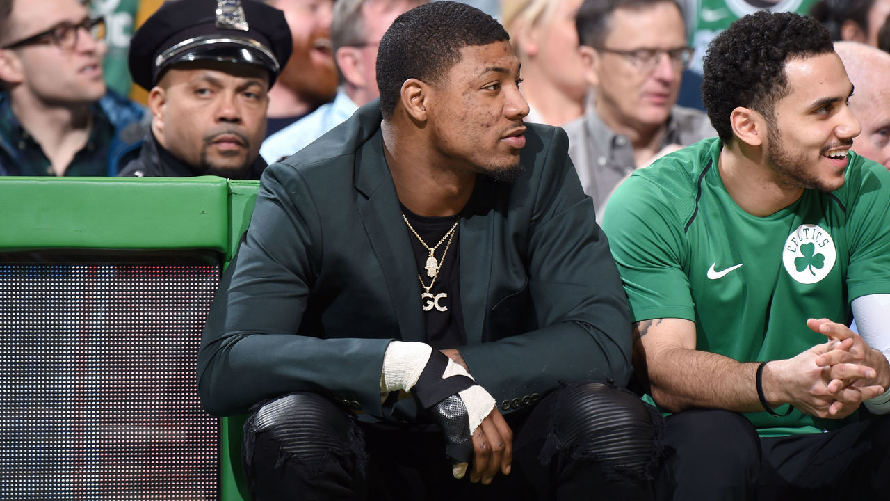 BOSTON, MA - JANUARY 31: Marcus Smart #36 of the Boston Celtics sits courtside during the game against the New York Knicks on January 31, 2018 at the TD Garden in Boston, Massachusetts. Mandatory Copyright Notice: Copyright 2018 NBAE