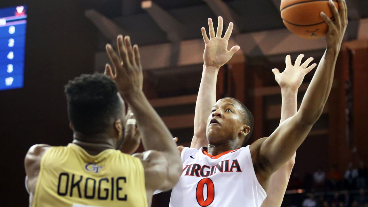 CHARLOTTESVILLE, VA - FEBRUARY 21: Devon Hall #0 of the Virginia Cavaliers shoots over Josh Okogie #5 of the Georgia Tech Yellow Jackets in the second half during a game at John Paul Jones Arena on February 21, 2018 in Charlottesville, Virginia. Virginia defeated Georgia Tech 65-54.