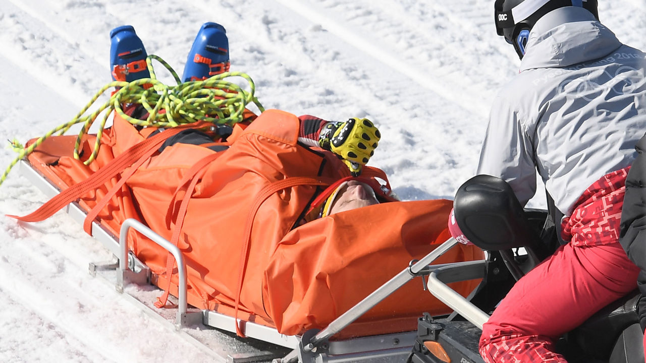 TOPSHOT - Canada's Christopher Delbosco is evacuated after being injured during the men's ski cross 1/8 final event during the Pyeongchang 2018 Winter Olympic Games at the Phoenix Park in Pyeongchang on February 21, 2018. / AFP PHOTO / LOIC VENANCE