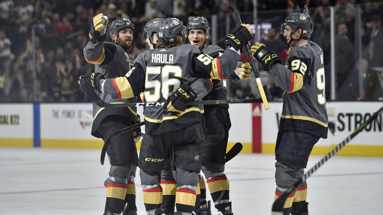 LAS VEGAS, NV - FEBRUARY 21: Tomas Nosek #92 celebrates his goal with Deryk Engelland #5, David Perron #57, Erik Haula #56 and Luca Sbisa #47 of the Vegas Golden Knights against the Calgary Flames during the game at T-Mobile Arena on February 21, 2018 in Las Vegas, Nevada.