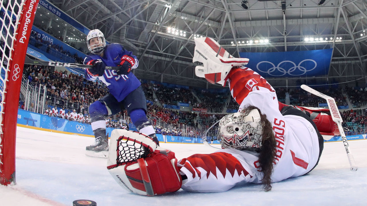 USA's Jocelyne Lamoureux-Davidson (L) scores on Canada's Shannon Szabados during the penalty-shot shootout in the women's gold medal ice hockey match between the US and Canada during the Pyeongchang 2018 Winter Olympic Games at the Gangneung Hockey Centre in Gangneung on February 22, 2018. / AFP PHOTO / POOL / -