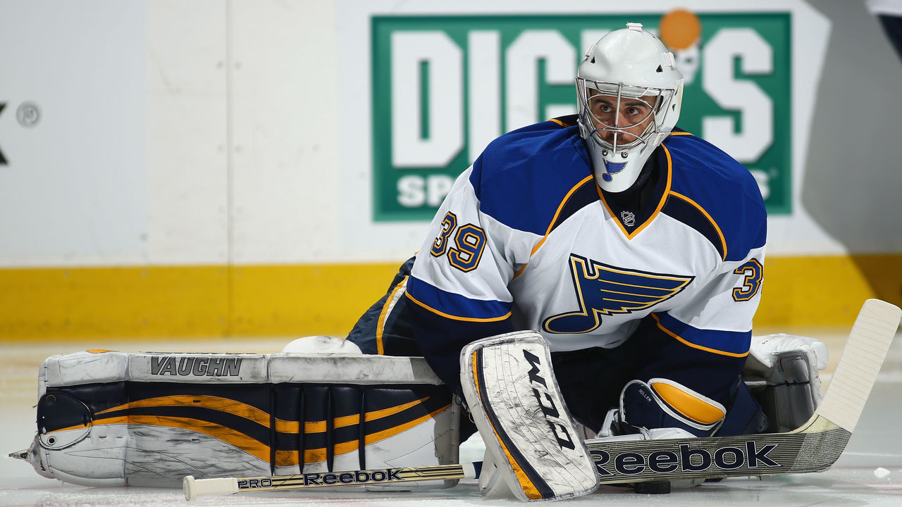 DENVER, CO - MARCH 08: Goalie Ryan Miller #39 of the St. Louis Blues stretches during warm ups prior to facing the Colorado Avalanche at Pepsi Center on March 8, 2014 in Denver, Colorado.