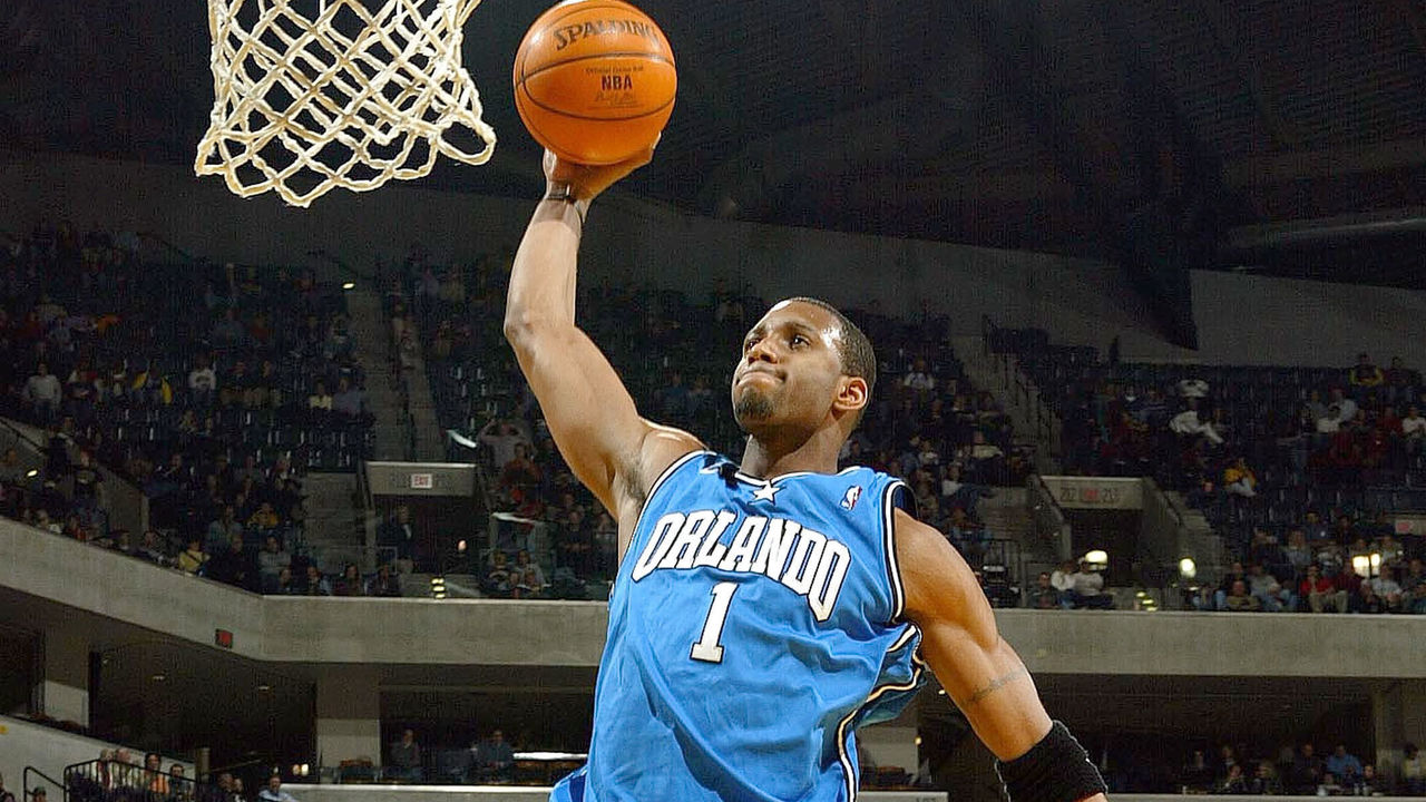 INDIANAPOLIS - DECEMBER 17: Tracy McGrady #1 of the Orlando Magic dunks the ball against the Indiana Pacers on December17, 2003 at Conseco Fieldhouse in Indianapolis, Indiana. The Magic won 94-90.
