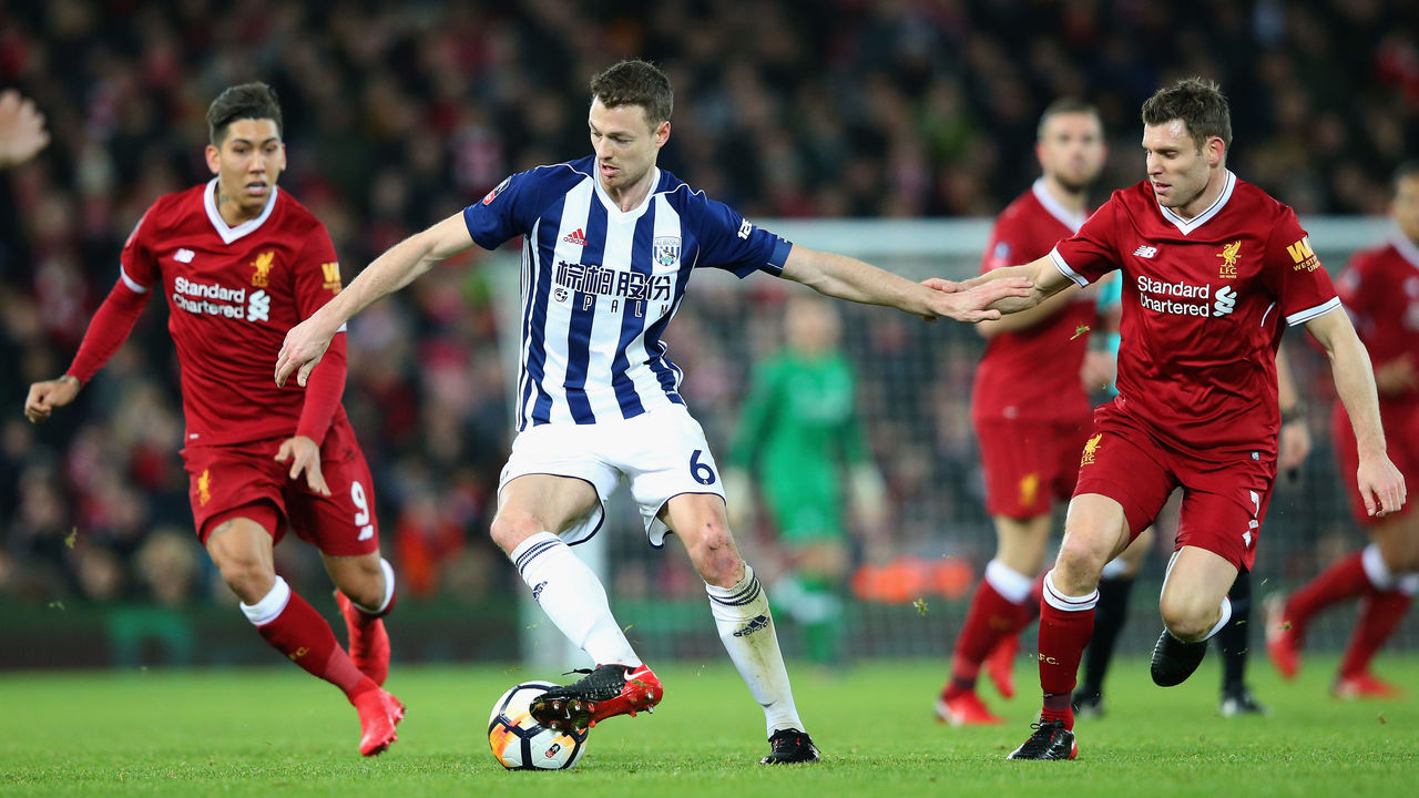 LIVERPOOL, ENGLAND - JANUARY 27: Jonny Evans of West Bromwich Albion holds off James Milner of Liverpool during The Emirates FA Cup Fourth Round match between Liverpool and West Bromwich Albion at Anfield on January 27, 2018 in Liverpool, England.
