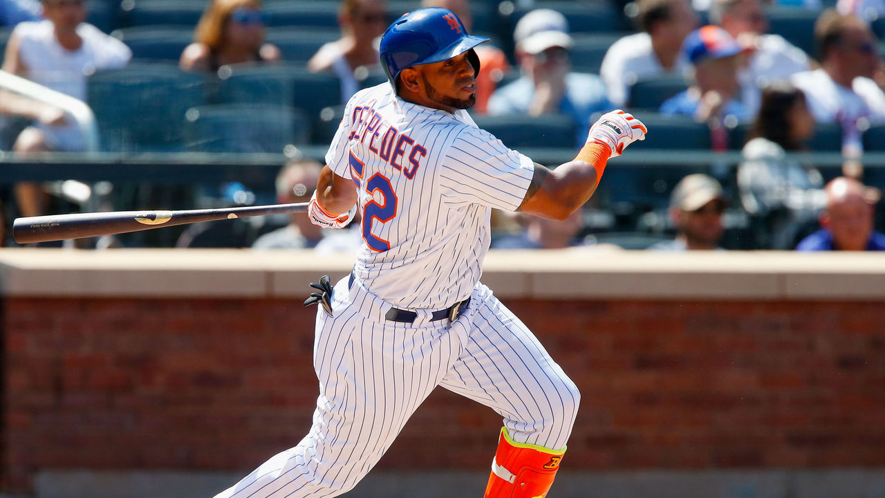 NEW YORK, NY - AUGUST 24: Yoenis Cespedes #52 of the New York Mets follows through on a sixth inning double against the Arizona Diamondbacks at Citi Field on August 24, 2017 in the Flushing neighborhood of the Queens borough of New York City.