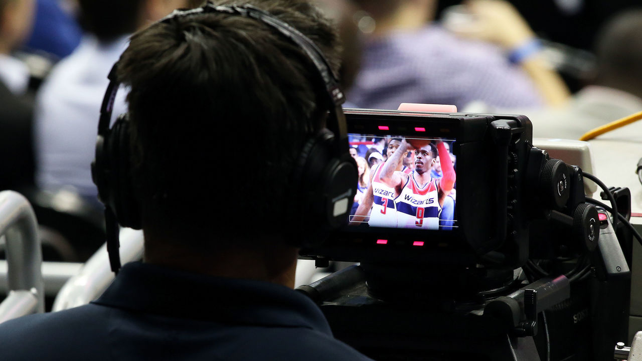 04 October, 2016: A camera man watches Washington Wizards guard Sheldon McClellan (9) take a foul shot during a preseason NBA game between the Washington Wizards and the Miami Heat at the Verizon Center in Washington D.C.