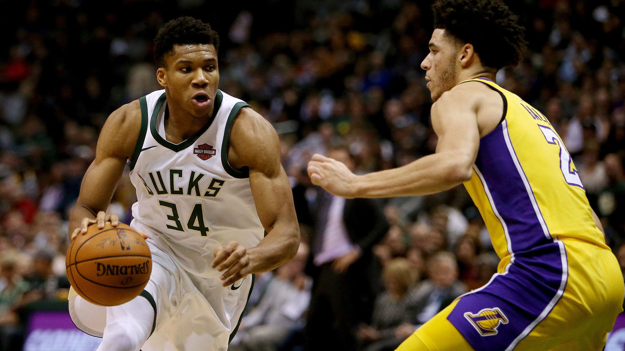 MILWAUKEE, WI - NOVEMBER 11: Giannis Antetokounmpo #34 of the Milwaukee Bucks dribbles the ball while being guarded by Lonzo Ball #2 of the Los Angeles Lakers in the second quarter at the Bradley Center on November 11, 2017 in Milwaukee, Wisconsin.