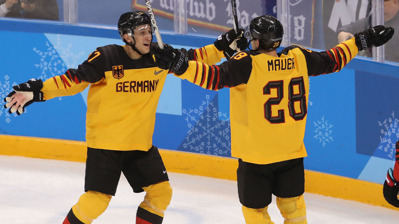 GANGNEUNG, SOUTH KOREA - FEBRUARY 23: Marcel Goc #57 and Frank Mauer #28 of Germany celebrate after a goal by Mauer in the second period during the Men's Play-offs Semifinals on day fourteen of the PyeongChang 2018 Winter Olympic Games at Gangneung Hockey Centre on February 23, 2018 in Gangneung, South Korea.