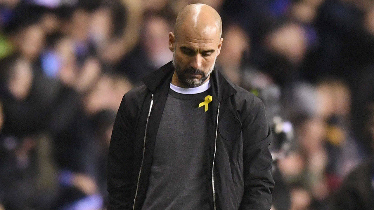 WIGAN, ENGLAND - FEBRUARY 19: Josep Guardiola, Manager of Manchester City looks dejected during the Emirates FA Cup Fifth Round match between Wigan Athletic and Manchester City at DW Stadium on February 19, 2018 in Wigan, England.
