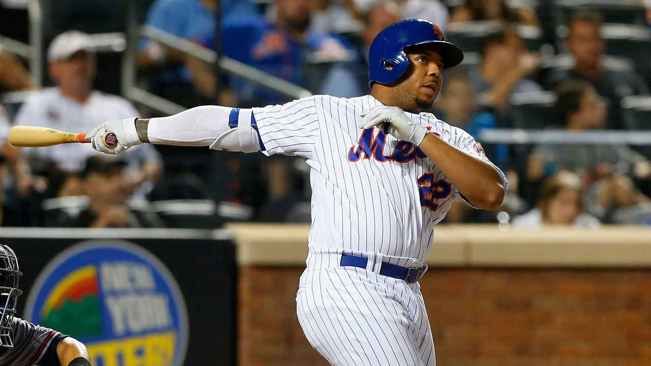 NEW YORK, NY - SEPTEMBER 27: Dominic Smith #22 of the New York Mets follows through on a seventh inning pinch hit three run home run against the Atlanta Braves at Citi Field on September 27, 2017 in the Flushing neighborhood of the Queens borough of New York City.
