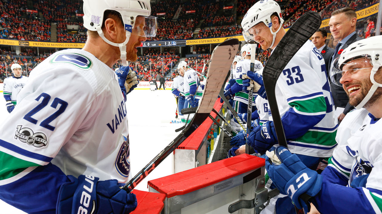 CALGARY, AB - NOVEMBER 7: Daniel Sedin #22 and Thomas Vanek #26 chat in an NHL game against the Calgary Flames at the Scotiabank Saddledome on November 7, 2017 in Calgary, Alberta, Canada.