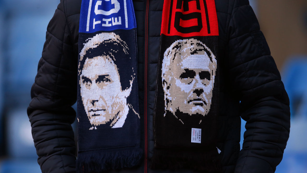 LONDON, ENGLAND - NOVEMBER 05: A fan wearing a scarf with the faces of Antonio Conte manager / head coach of Chelsea and Jose Mourinho the head coach / manager of Manchester United before the Premier League match between Chelsea and Manchester United at Stamford Bridge on November 5, 2017 in London, England.
