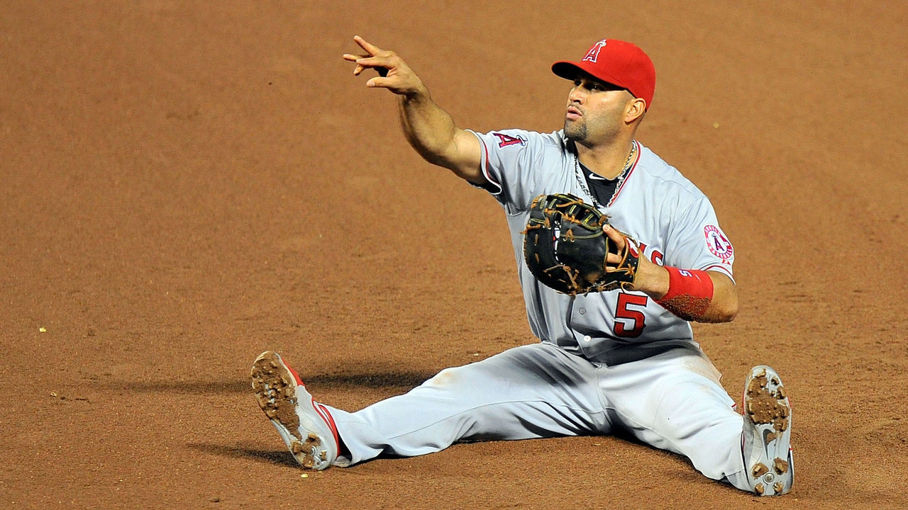 BALTIMORE, MD - MAY 16: Albert Pujols #5 of the Los Angeles Angels throws the ball to first base to put out David Lough #9 (not pictured) of the Baltimore Orioles in the fifth inning at Oriole Park at Camden Yards on May 16, 2015 in Baltimore, Maryland.