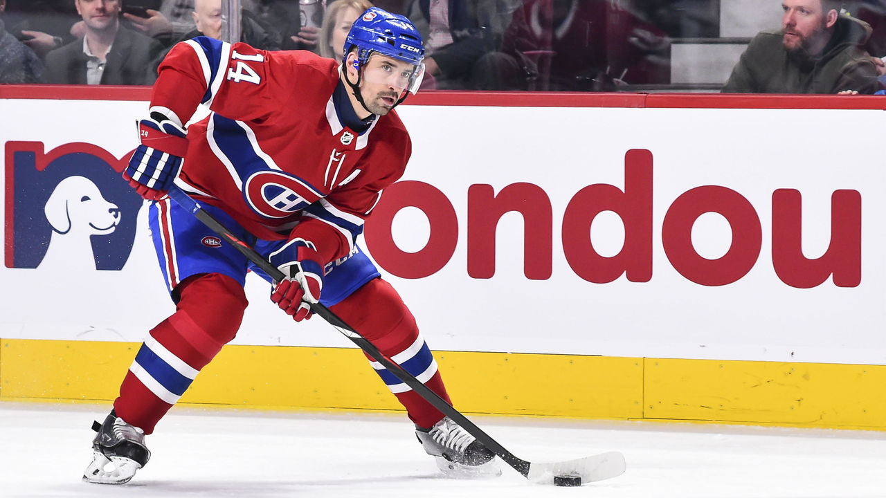 MONTREAL, QC - JANUARY 07: Tomas Plekanec #14 of the Montreal Canadiens skates the puck against the Vancouver Canucks during the NHL game at the Bell Centre on January 7, 2018 in Montreal, Quebec, Canada. The Montreal Canadiens defeated the Vancouver Canucks 5-2.