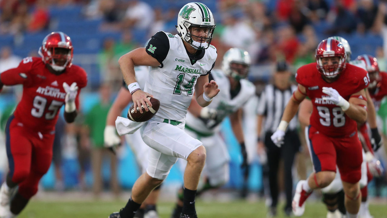 BOCA RATON, FL - NOVEMBER 3: Chase Litton #14 of the Marshall Thundering Herd scrambles out of the pocket during first quarter action against the Florida Atlantic Owls at FAU Stadium on November 3, 2017 in Boca Raton, Florida.
