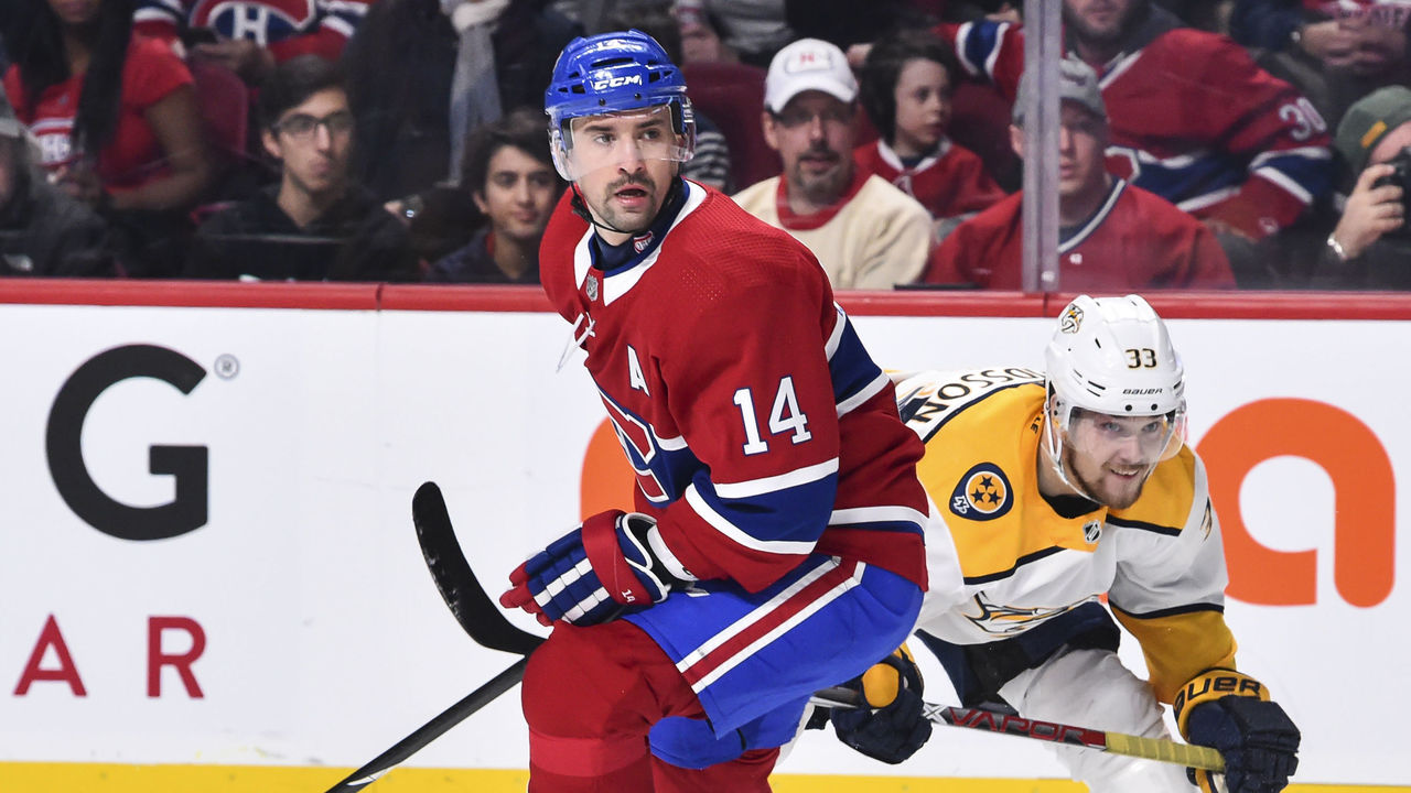 MONTREAL, QC - FEBRUARY 10: Tomas Plekanec #14 of the Montreal Canadiens skates against Viktor Arvidsson #33 of the Nashville Predators during the NHL game at the Bell Centre on February 10, 2018 in Montreal, Quebec, Canada. The Nashville Predators defeated the Montreal Canadiens 3-2 in a shootout.