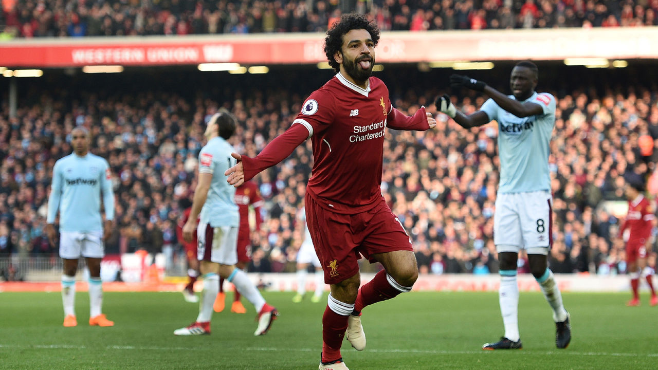 Liverpool's Egyptian midfielder Mohamed Salah celebrates scoring the team's second goal during the English Premier League football match between Liverpool and West Ham United at Anfield in Liverpool, north west England on February 24, 2018. / AFP PHOTO / Oli SCARFF /