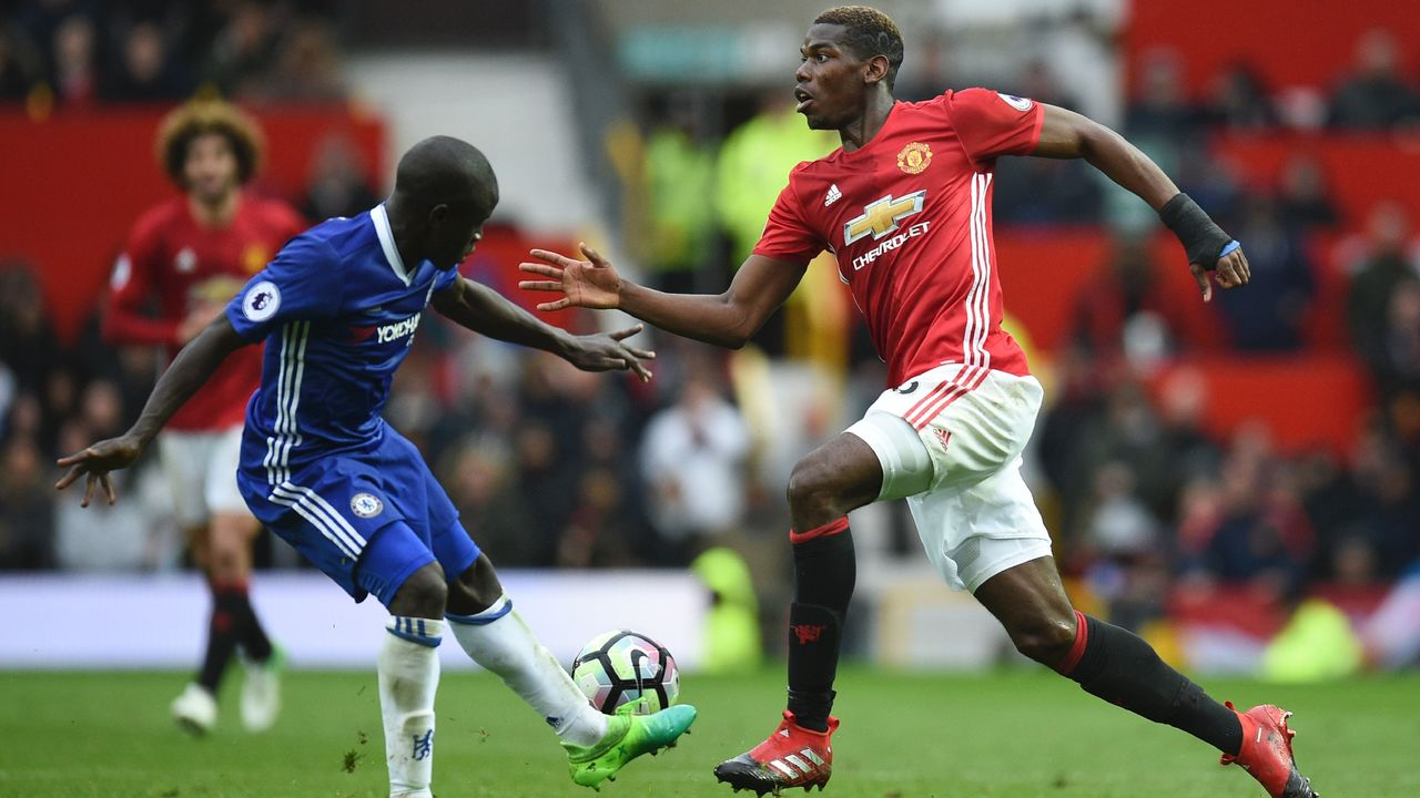 Manchester United's French midfielder Paul Pogba (R) takes on Chelsea's French midfielder N'Golo Kante (L) during the English Premier League football match between Manchester United and Chelsea at Old Trafford in Manchester, north west England, on April 16, 2017. / AFP PHOTO / Oli SCARFF /