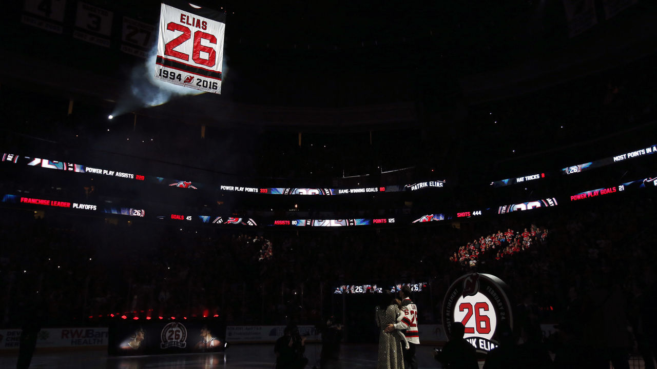 NEWARK, NJ - FEBRUARY 24: Former New Jersey Devil Patrik Elias stands with his family to watch his #26 jersey hoisted to the rafters during a retirement ceremony prior to a game against the New York Islanders at the Prudential Center on February 24, 2018 in Newark, New Jersey.