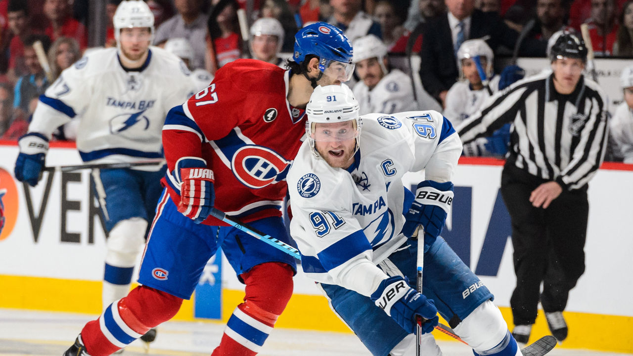 MONTREAL, QC - MAY 09: Steven Stamkos #91 of the Tampa Bay Lightning moves the puck in Game Five of the Eastern Conference Semifinals against the Montreal Canadiens during the 2015 NHL Stanley Cup Playoffs at the Bell Centre on May 9, 2015 in Montreal, Quebec, Canada. The Canadiens defeated the Lightning 2-1. The Lightning lead the series 3-2.