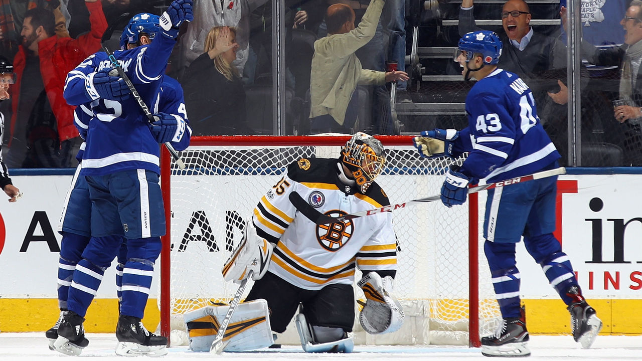 TORONTO, ON - NOVEMBER 10: The Toronto Maple Leafs celebrate a game tying goal by James van Riemsdyk #25 (l) against Anton Khudobin #35 of the Boston Bruins at 19:00 of the third period at the Air Canada Centre on November 10, 2017 in Toronto, Canada. The Leafs defeated the Bruins 3-2 in overtime.