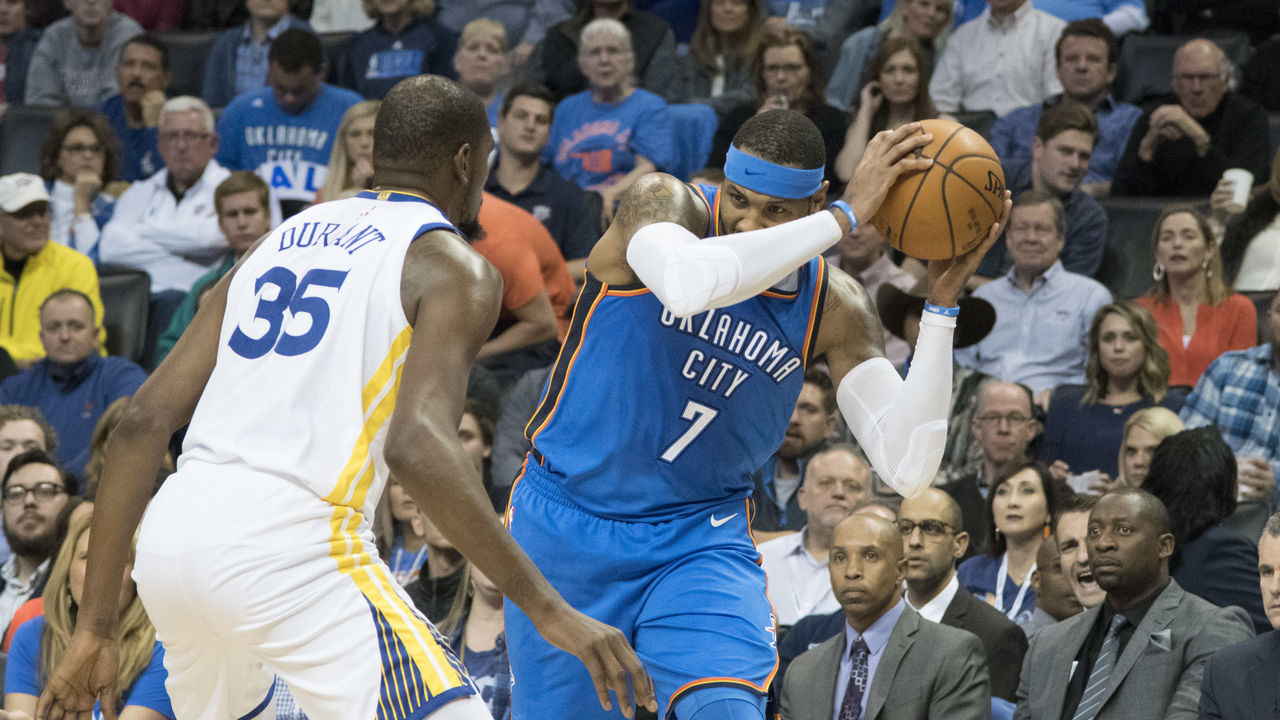 OKLAHOMA CITY, OK - NOVEMBER 22: Carmelo Anthony #7 of the Oklahoma City Thunder keeps the ball away from Kevin Durant #35 of the Golden State Warriors during the first half of a NBA game at the Chesapeake Energy Arena on November 22, 2017 in Oklahoma City, Oklahoma.